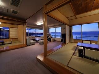 貴賓室(12畳+6畳+TWベッド+応接ソファ)の夕景